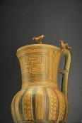 Jug with lid decorated with two tinny bird figurines